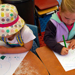 Girls drawing at St Mary's childcare centre.